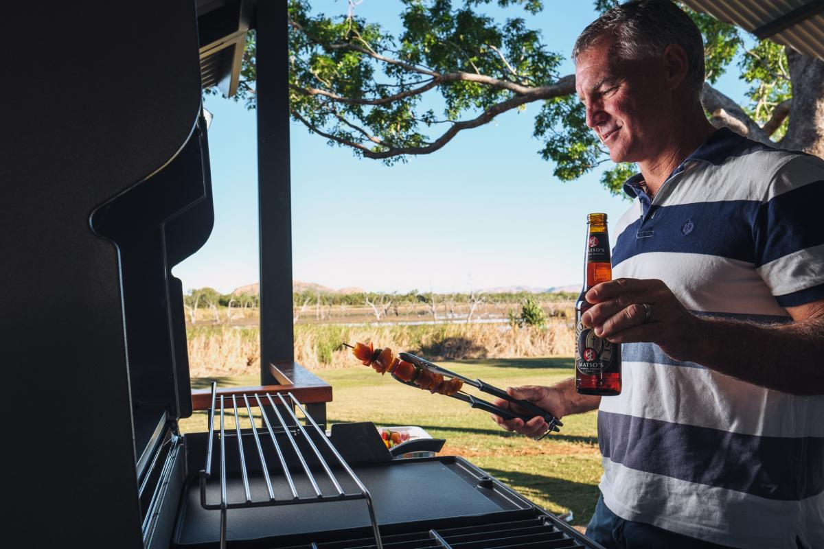 Private BBQ and Deck at Kimberleyland Deluxe Waterfront Cabin Accommodation in Kununurra