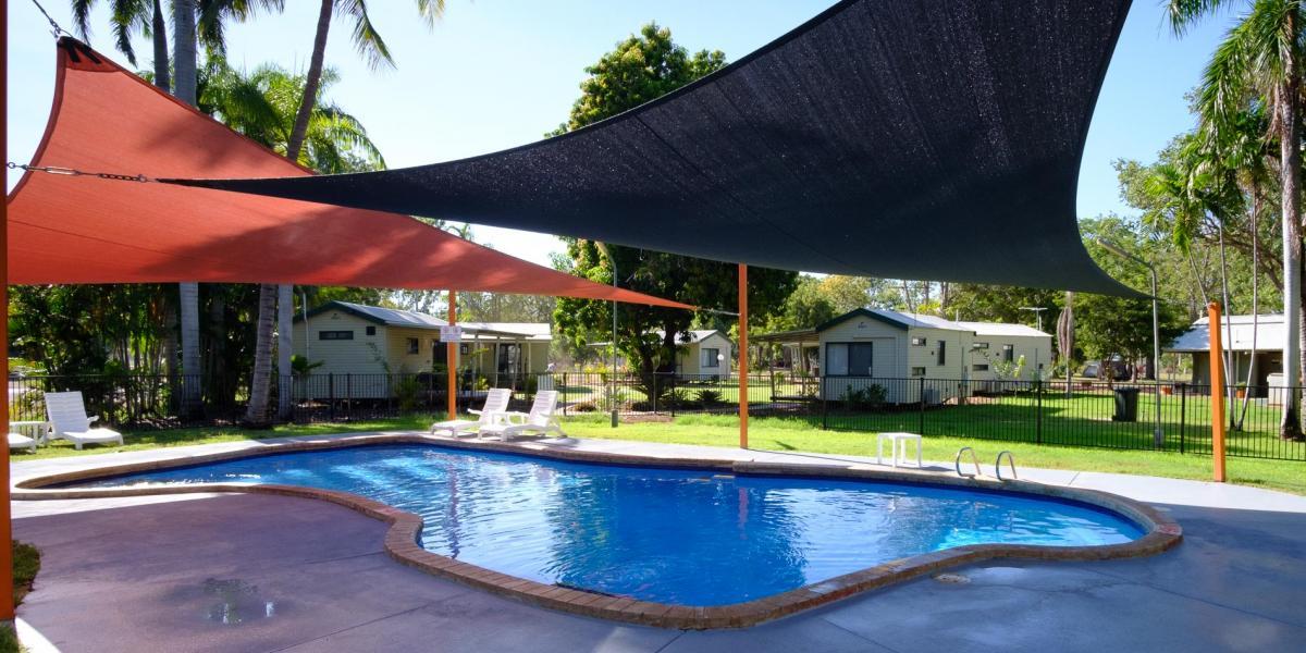 Cabins background to Kimberleyland Swimming Pool